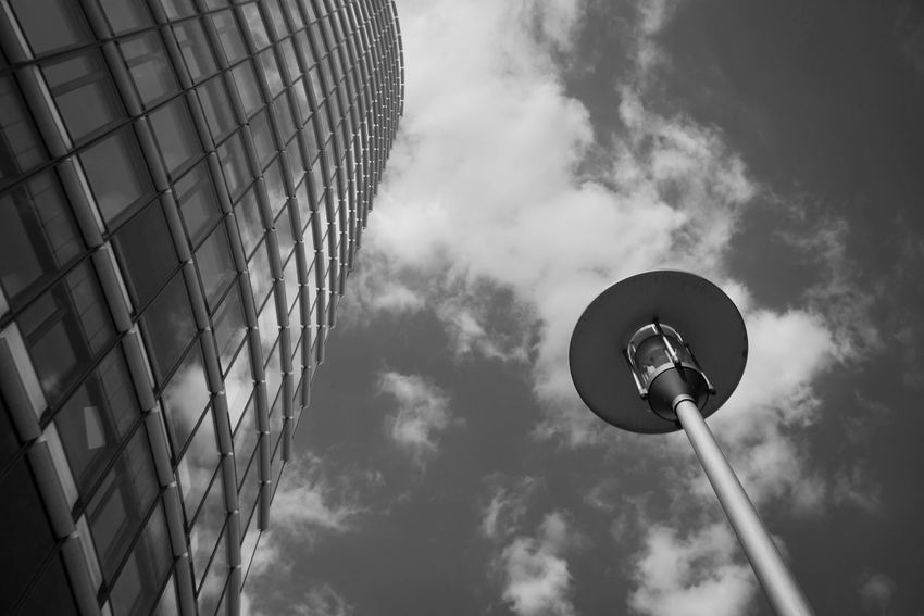 Black And White Street Lamp Low Angle View Sky Cloud - Sky Architecture Building Exterior Built Structure No People City Day Building Tall - High Outdoors Street Lighting Equipment Office Building Exterior Modern