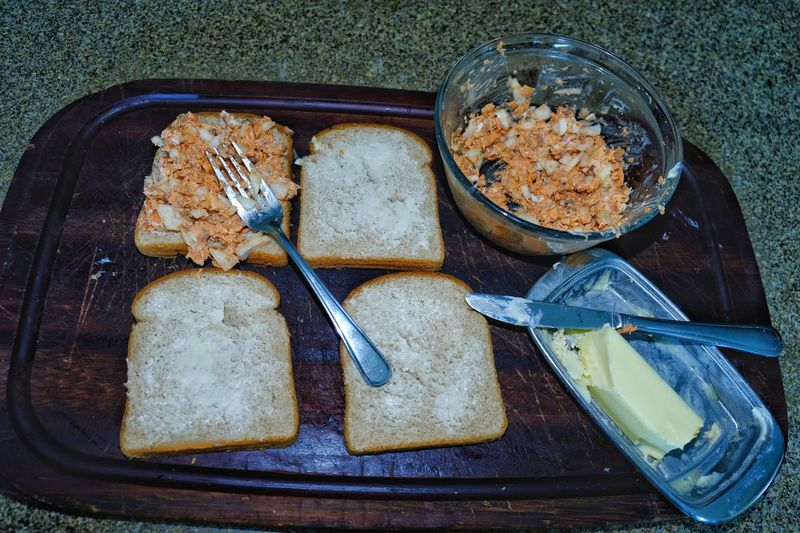 Salmon sandwich on whole wheat bread preparation on dark wood cutting board high angle view Canned Salmon Lunch Lunch Preparation  Tinned Salmon Close-up Dairy Product Directly Above Food Food And Drink Freshness Glass Healthy Eating High Angle View Household Equipment Indoors  Meal Meal Preparation No People Ready-to-eat SLICE Snack Table Knife Temptation Wellbeing Whole Wheat Bread