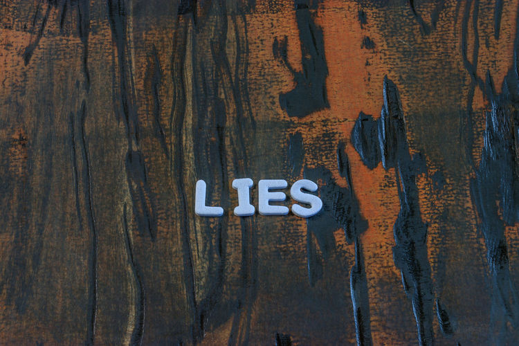 Backgrounds Brown Close-up Communication Day Directly Above Education Full Frame Indoors  Liar Lie Lies Metal No People Number Rough Text Textured  Tree Untruth Western Script Wood Wood - Material