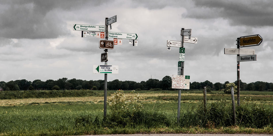 Bicycle Track Cloud Cloud - Sky Communication Day Direction Field German Thoroughness Hiking Trail Information Sign Landscapes With WhiteWall Nature Overcast Road Sign Sign Tourist Destination Feel The Journey