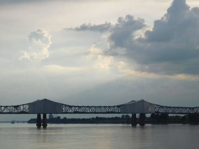 Built Structure Outdoors Cloud - Sky Bridge - Man Made Structure Sky No People Sunlight Business Finance And Industry Sea Architecture Water Silhouette Beach Day Nature Fog Scenics Sunset Horizon Over Water Building Exterior Natchez / Vidalia Bridge