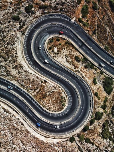 Aerial view of vehicles on winding road