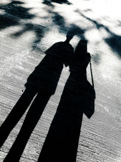 Shadow Real People Focus On Shadow Shadow Sunlight Lifestyles Two People Standing Women Outdoors Men Togetherness Day Leisure Activity Bonding Human Hand Human Body Part Adults Only Adult People