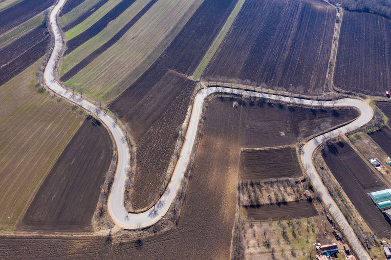 Aerial view of winding countryside road and agricultural fields from a drone No People Road Transportation High Angle View Day Outdoors Nature Aerial View Environment Landscape Highway Curvy Road Asphalt Drone  Dronephotography Drone Photography Droneshot Aerial Aerial Photography Aerial Shot Aerial Landscape Travel Journey Road Roadtrip