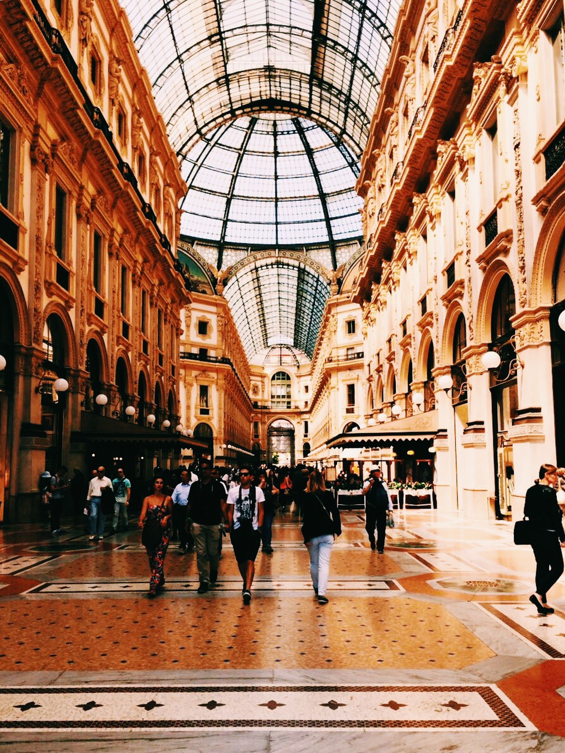 indoors, architecture, built structure, men, large group of people, person, ceiling, walking, lifestyles, arch, leisure activity, city life, railroad station, travel, shopping mall, flooring, window, group of people, full length