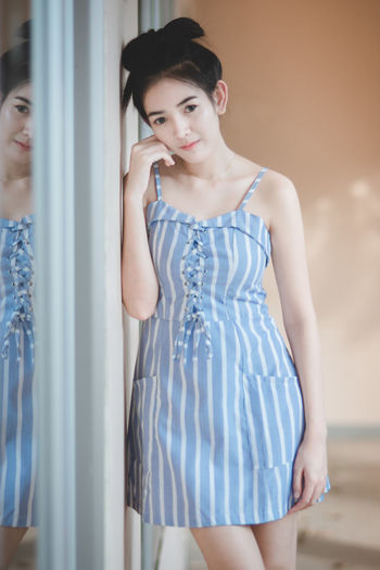 One Person Fashion Three Quarter Length Standing Young Adult Indoors  Front View Real People Lifestyles Clothing Casual Clothing Leisure Activity Dress Young Women Beauty Looking Beautiful Woman Adult Women Hairstyle Contemplation