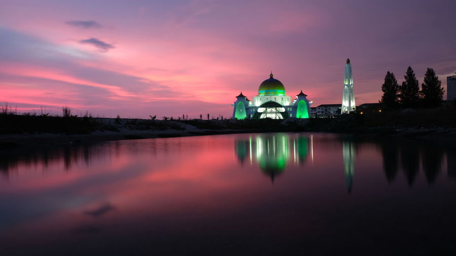 Magnificent Sunset at The Strait Mosque of Malacca, Malaysia. Masjid Selat Malacca Tourusm Visit Malacca Amazing Mosque World Mosque Madinah Praying Islam.muslim Red Sky At Sunset Reflection Night Architecture Religion Business Finance And Industry Sunset Building Exterior Travel Destinations Dome No People Sky Illuminated Spirituality Built Structure Lake Outdoors Water