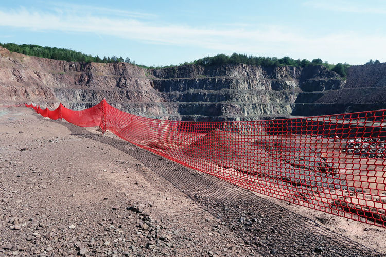 open pit mine. Cloud Cloud - Sky Day Idyllic Landscape Mine Mining Mining Heritage Mining Industry Mountain No People Outdoors Quarry Quarry Rock Red Remote Rock Rock - Object Rock Formation Safety First! Safety Net Scenics Sky Surface Mine Surface Mining