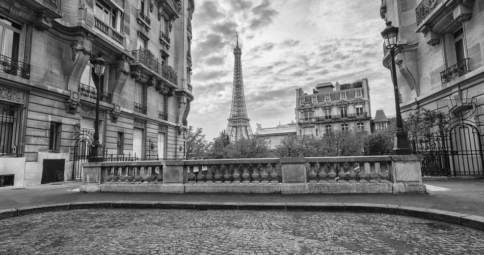 view of the Eiffel Tower from the Avenue de Camoens of in paris, france in black and white colors Architecture Avenue De Camoens Cityscape Eiffel Tower Famous France Lantern Paris Paris, France  Romantic Seine Skyline Traveling View Black And White Curbstone Dramtic Clouds Eiffel Europe Famous Place French Oldtown Street Tourism Travel Destinations