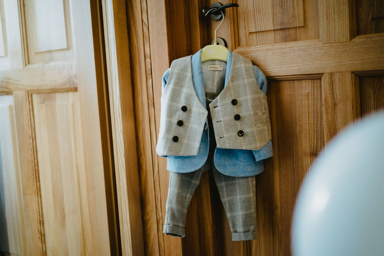 Close-up of clothes hanging on wooden door