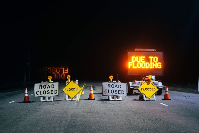Text Communication Illuminated Night Outdoors No People Flooding Road Sign Road Closed Sign Road Closed Winter Storm Fresh On Market 2017