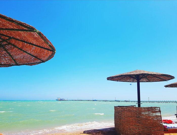 Sea Clear Sky Beach Water Blue Summer Sand Sky Horizon Over Water Sun Lounger Beach Umbrella Umbrella