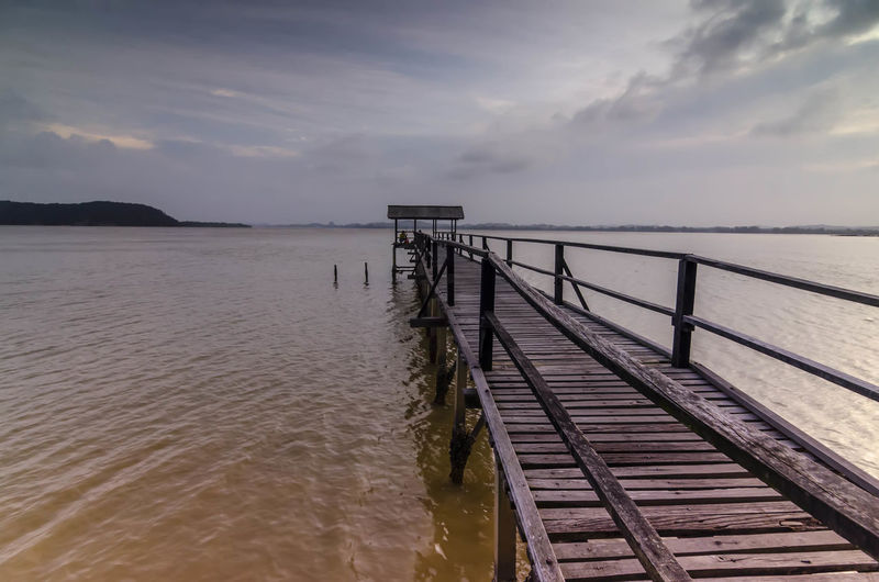 Wooden bridge for fishing spot Water Sky Sea Scenics - Nature Cloud - Sky Beauty In Nature Tranquil Scene Tranquility Nature Railing No People Sunset Non-urban Scene Idyllic Pier Wood - Material Day Built Structure Outdoors