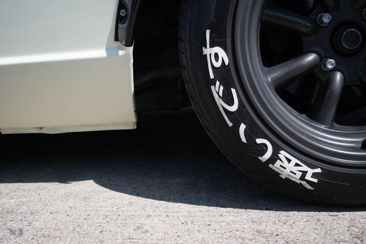 Hiragana Japanese Letters Car Close-up Kanji Signs Road Tire Vehicle Part Wheel