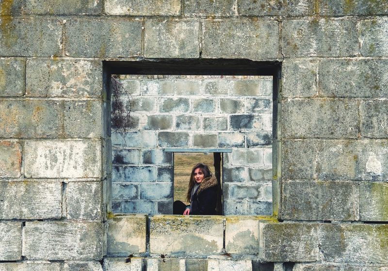 Young Women Women Standing Window Architecture Building Exterior Built Structure Thoughtful Wall Pretty Thinking Worn Out Attractive Caucasian Head And Shoulders