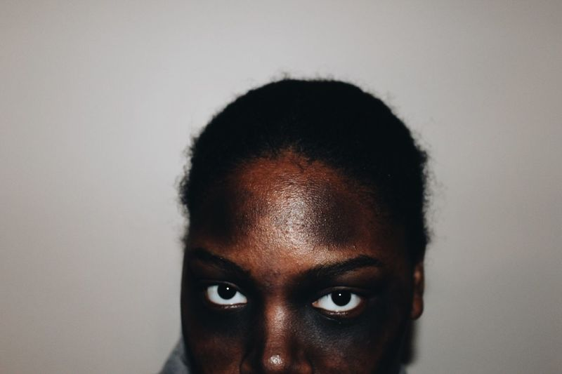 Close-up of young woman wearing face paint