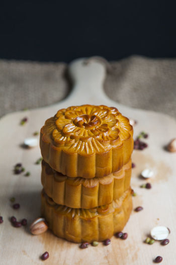 Close-up of moon cakes with seeds arranged on cutting board