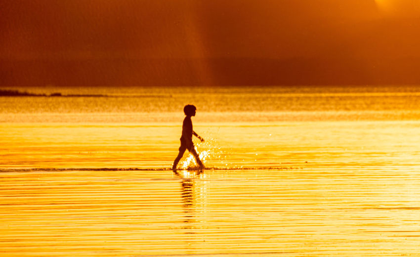 Kid silhouette at sunset