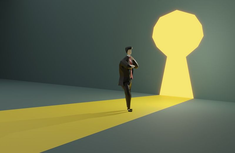 Rear view of man standing against yellow wall