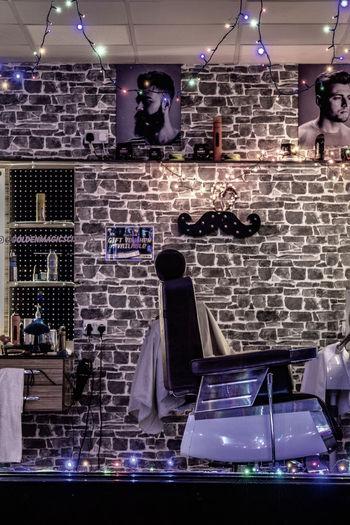 Barbers shop window at night, Bury St Edmunds, Suffolk Barber Shop Hair Salon Mens Hair Salon Illuminated Haircut Haircut Time Chair Christmas Lights Shop Window Shop Windows Street View Looking Inside Salon Chair Lighting
