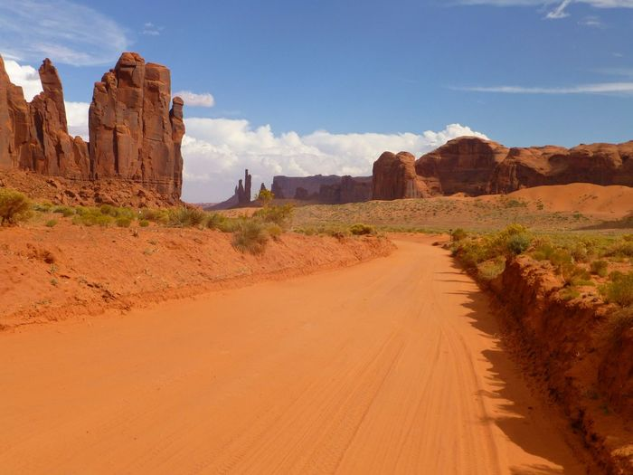 Beautiful monument valley Sky Scenics - Nature Land Nature Environment Beauty In Nature Day Rock Formation Non-urban Scene Travel Destinations Landscape Sunlight Cloud - Sky Tranquil Scene Travel Tranquility Transportation Road The Way Forward Direction No People Arid Climate Climate