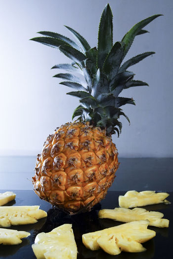 pineapple Pineapple Tropical Fruit Food And Drink Food Fruit Healthy Eating Freshness Wellbeing Indoors  No People Close-up Still Life Nature Table Plant Tropical Climate Ripe Focus On Foreground Home Interior Leaf