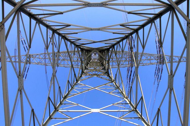 Full frame shot of electricity pylon against clear blue sky