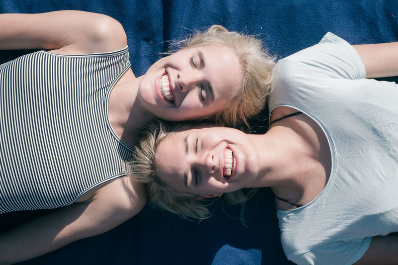 TWINS Blond Hair Bonding Day Happiness Home Interior Indoors  Leisure Activity Lifestyles Looking At Camera Portrait Real People Smiling Togetherness Twins Two People Young Adult Young Women BYOPaper! Live For The Story