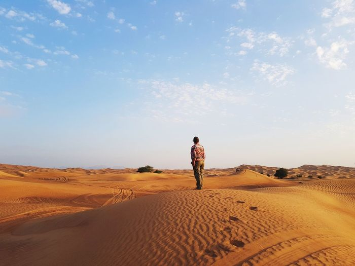 Sand Full Length Sand Dune Desert One Person Adults Only Only Women One Woman Only Day Sky Standing Arid Climate People Outdoors Landscape Cloud - Sky Desert Nofilter Dubai❤ Nature Dubai No People Young Adult Scenics Nature Be. Ready.