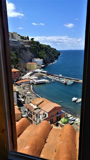 Window view of Marina Grande from Sorrento, Italy. Bay Of Naples Italia Marina Grande Mediterranean  Architecture Bay Of Naples, Italy. Beauty In Nature Building Exterior Built Structure Day High Angle View Horizon Over Water Italy Nature Nautical Vessel Outdoors Sea Sky Sorrento Sorrento Coast Sorrento, Italia Sorrentocoast Sunlight Tree Water Adventures In The City The Traveler - 2018 EyeEm Awards