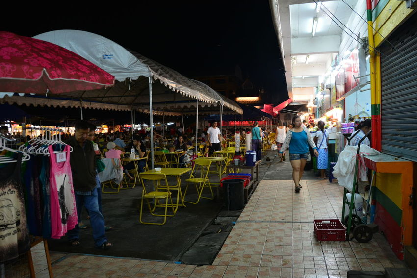 Alley Bazaar Built Structure Casual Clothing Chiang Rai, Thailand City City Life Day Group Of People Large Group Of People Leisure Activity Lifestyles Market Market Stall Medium Group Of People Mixed Age Range Multi Colored Night Night Bazaar Outdoors Person Retail  Store The Way Forward
