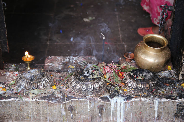 High angle view of lota with religious offerings at buddhist temple