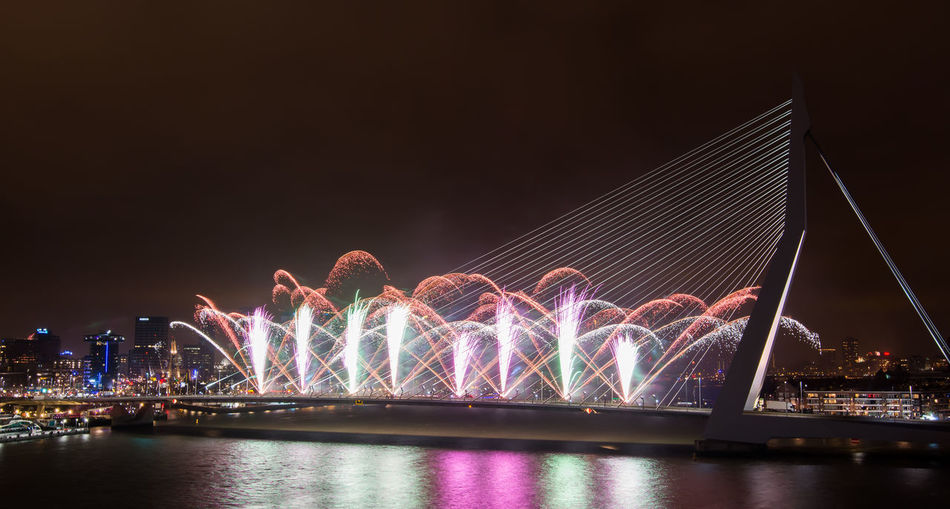 Firework Exploding Over Erasmus Bridge At Night