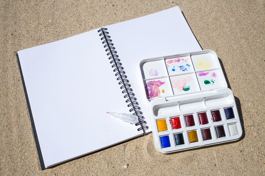 Notebook & Watercolor box on beach background Blue Color Copy Space Green Color PaintBox Rainbow Colors Text Art Backgrounds Beach Blank Book Colorful Directly Above High Angle View Multi Colored Notebook Painting Paper Pen Red Color Sand Still Life Thailandtravel White Color Yellow Color