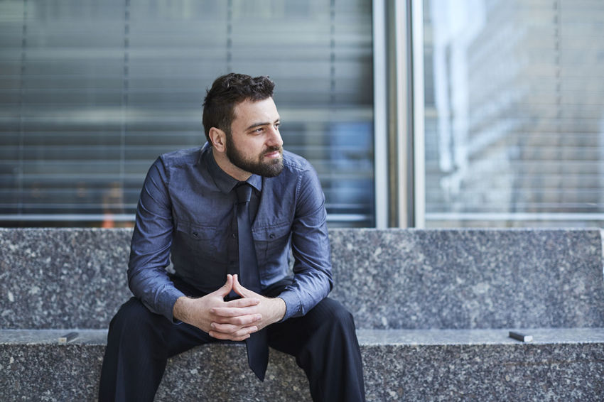Adult Beard Bench Blue Brazilian Business Business Man Businessman Confidence  Entrepreneur Finance Hands Clasped Handsome Looking Away Man Sitting Start Up Technology Urban Well-dressed Young Man