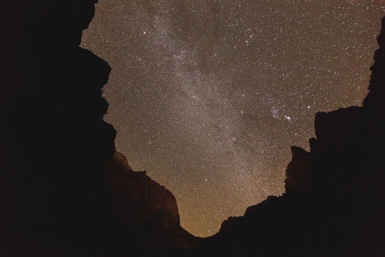 Milky Way and stars over Zion National Park in Utah, USA. EyeEmNewHere Astronomy Beauty In Nature Constellation Galaxy Low Angle View Milky Way Nature Night No People Outdoors Rock - Object Scenics Silhouette Sky Space Space Exploration Star - Space Tranquility