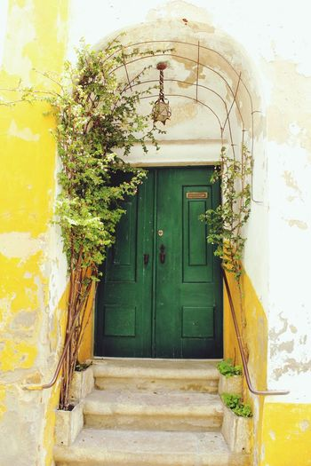 Door Closed Entrance Built Structure Architecture Green Color Building Exterior No People Outdoors Safety House Day Protection Doorway Yellow Close-up Obidos Portugal Óbidos  Portugal MedievalTown Medieval Architecture Live For The Story BYOPaper! The Street Photographer - 2017 EyeEm Awards Paint The Town Yellow