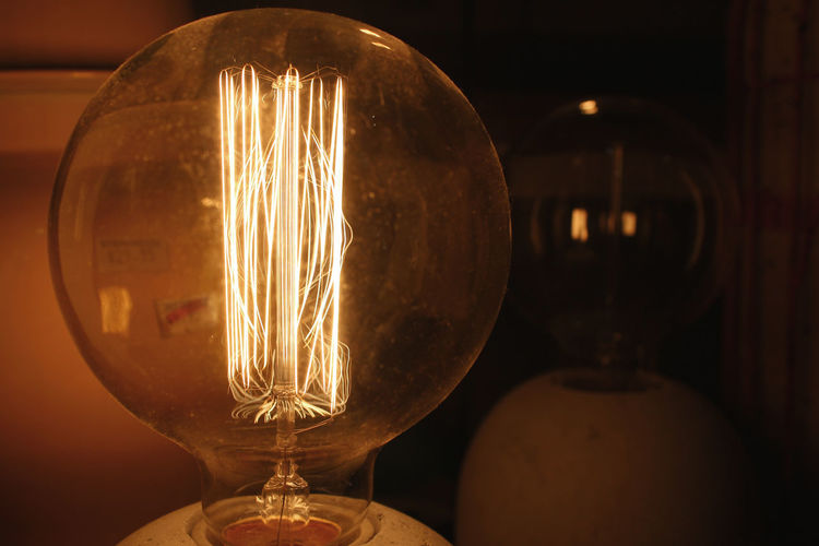 Close-up Electric Light Focus On Foreground Glowing Illuminated Light Bulb Lighting Equipment No People Sphere