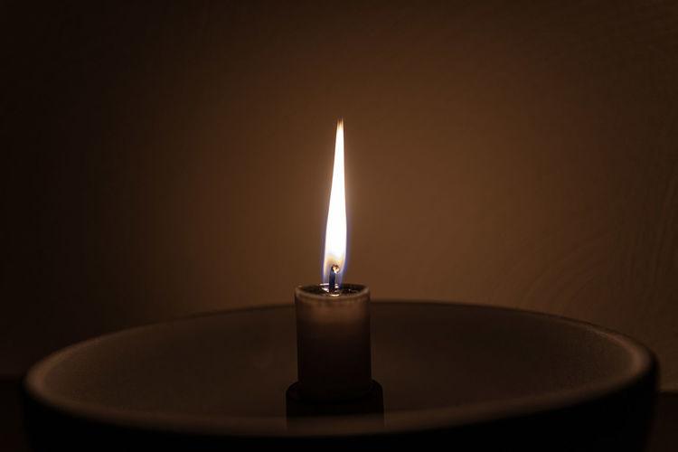 Close-up of illuminated lamp against black background