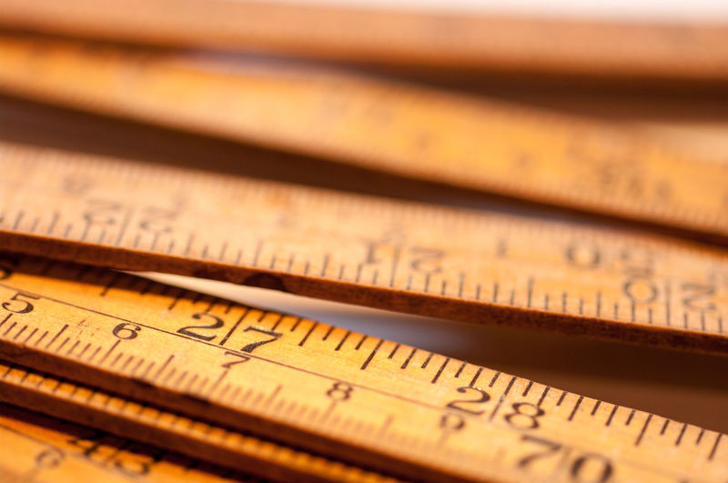 Close-Up Of Wooden Rulers On Table