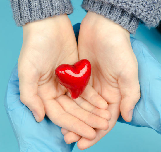 Close-up of woman holding heart shape