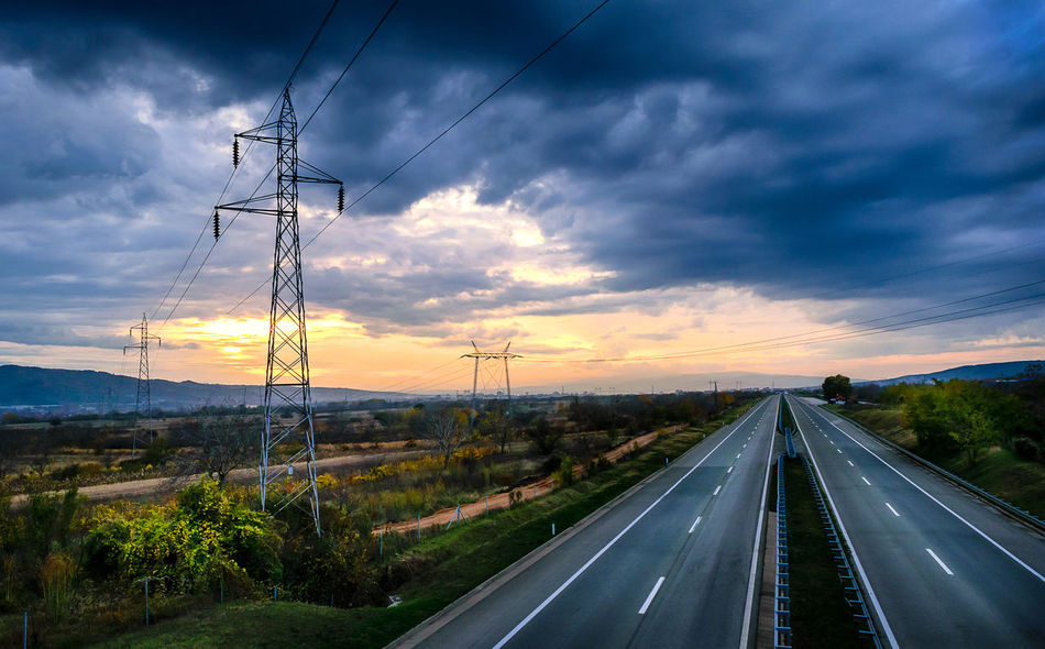 Asphalt Autobahn Cable Car Cloud - Sky Connection Day Electricity  Electricity Pylon Highway Landscape Motorway Nature No People Outdoors Power Line  Road Sky Sunset Technology The Way Forward Transportation