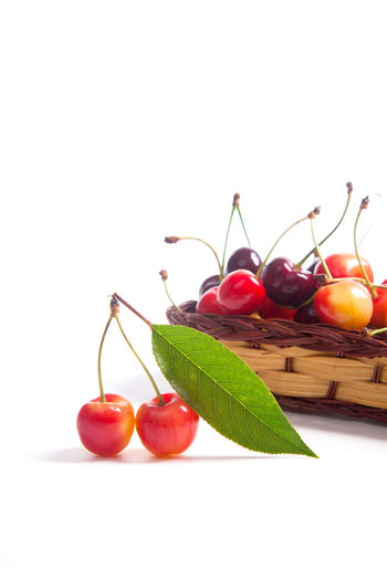 Cherry Close-up Copy Space Food Food And Drink Freshness Fruit Healthy Eating Indoors  Leaf No People Plant Part Red Ripe Still Life Studio Shot Table Temptation Vegetable Wellbeing White Background Wood - Material