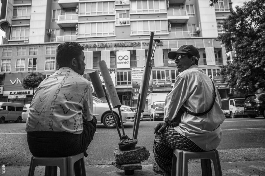Plumbers waiting for the call. Since the downtown area is filled with apartments, they often have the pipe problems. Plumbers are waiting on the road, showing off their equipments and expecting a call for the living. Rangoon Adult Adults Only Architecture Bnw Building Exterior Built Structure Cap City Day Men Myanmar Occupation Outdoors People Plumber Real People Sitting Street Urban