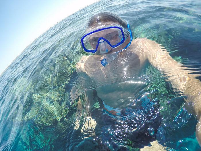Man Snorkeling In Sea