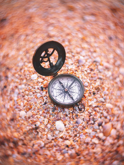 High angle view of clock on metal