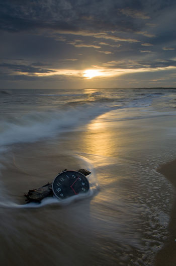 Concept alarm clock on beach of island, malaysia. Long Exposure Background Malaysia Wallpaper Fine Art Photography Wall Clock Water Sea Wave Sunset Beach Low Tide Sand Sunlight Reflection Romantic Sky Flowing Water