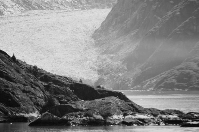 The glacier as its tail sweeps around the corner. Fjord Alaska. On And On Nature_collection Popular Photos The Week on EyeEm EyeEmNewHere EyeEm Nature Lover Eye4photography  Alaska Fjord Frozen Ice Rock Formation Blackandwhite Glacier Mountain Sea Nature Water Beauty In Nature Tranquility Rock - Object Scenics No People Tranquil Scene Outdoors Waterfront Day Scenery