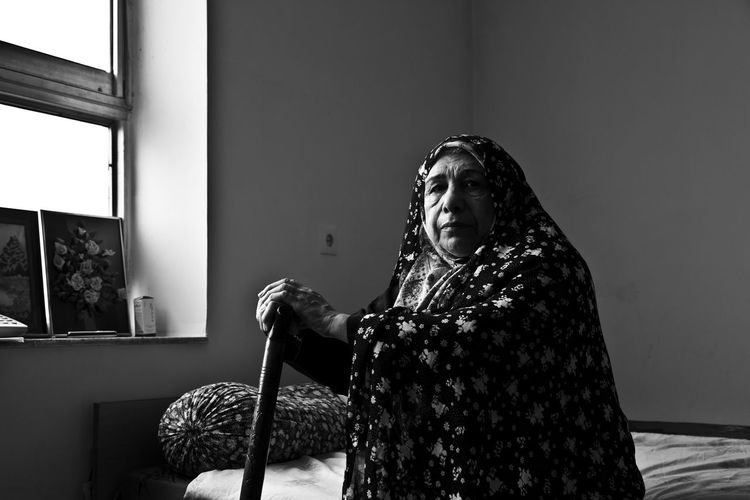 This is a portrait of woman who lost one of ten children at Iraq and iran war but she was depressed because no one of her children didn't come to meet herm she live alone with his sick husband's. The Portraitist - 2015 EyeEm Awards Bojnord The Adventure Handbook The Moment - 2015 EyeEm Awards