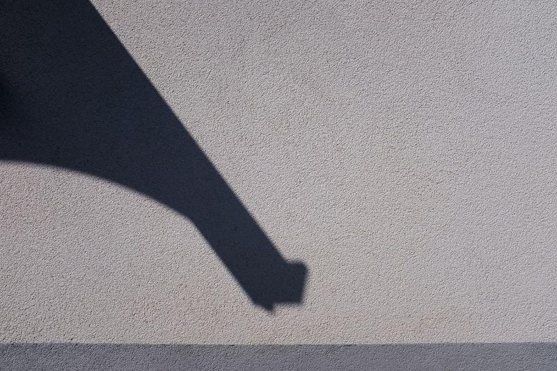 High angle view of shadow on wall
